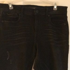 Black denim stretch jeans with distressed look
